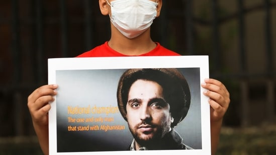 An Afghan boy holds up a sign with the image of Ahmad Massoud as he takes part in a protest against Pakistan in New Delhi.(Reuters Photo)