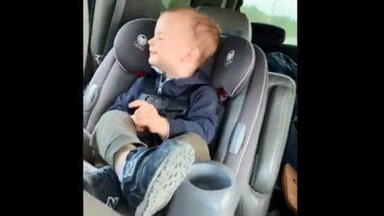 The image taken from the video shows a kid enjoying a car ride.(Screengrab)