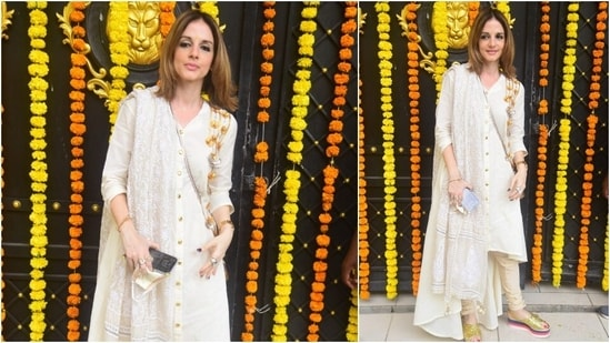 Sussanne Khan grabbed eyeballs as she posed for the camera in a white salwar suit.(HT Photo/Varinder Chawla)