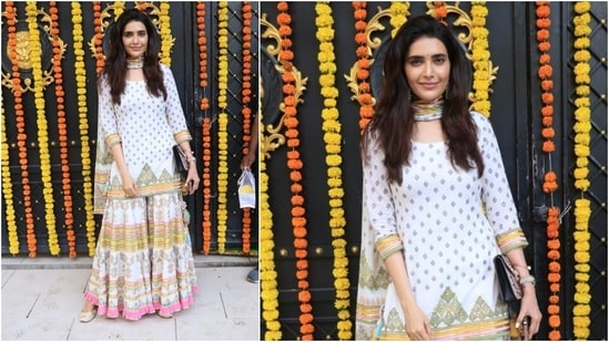 Karishma Tanna looked stunning in a printed sharara. She teamed her look with heavy earrings, bindi, ring, watch and a purse.(HT Photo/Varinder Chawla)