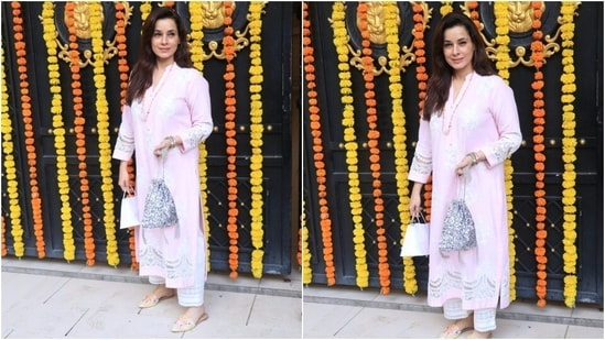 Neelam Kothari looked beautiful in a simple embroidered pink salwar suit.(HT Photo/Varinder Chawla)