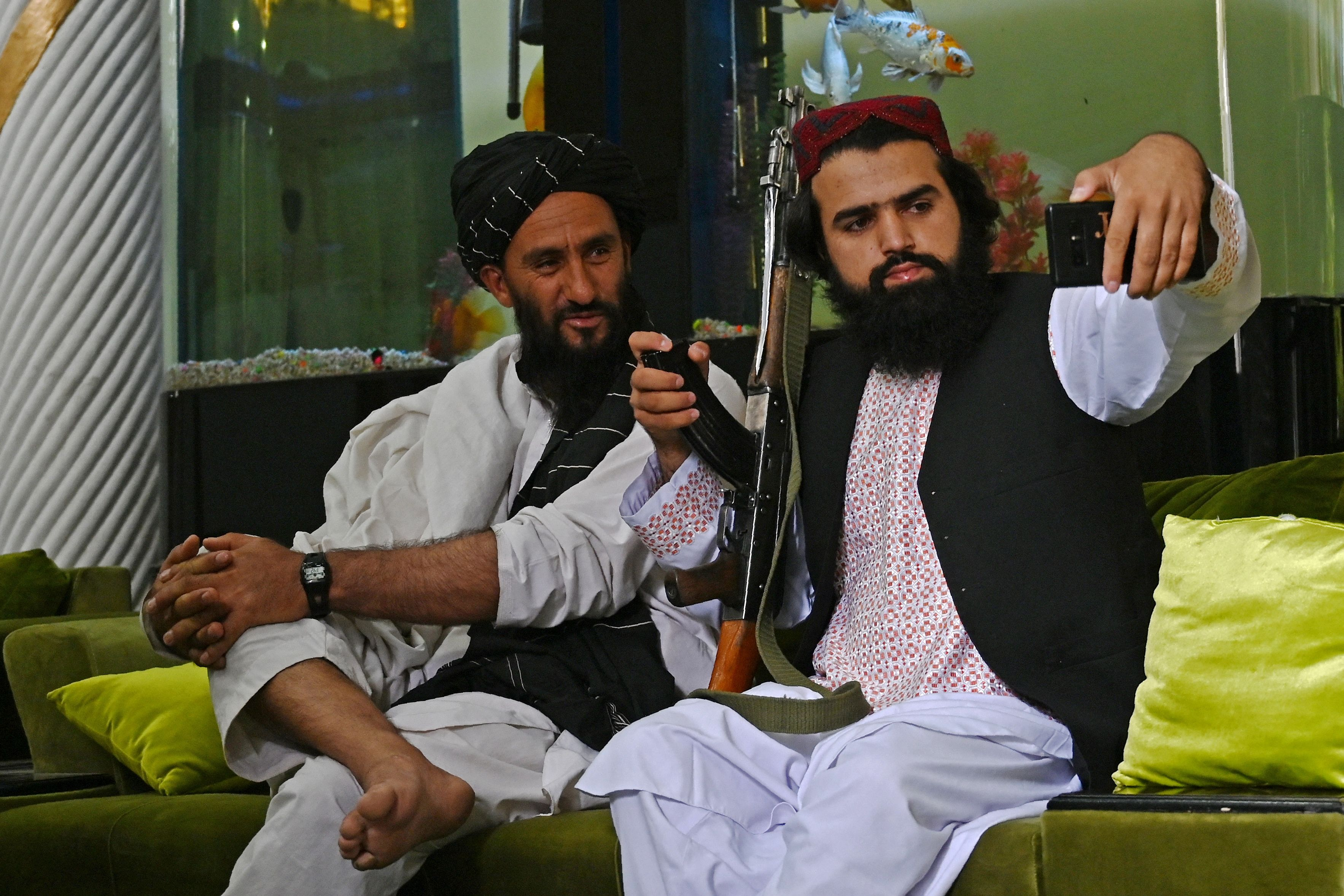 Taliban fighters take a selfie in Kabul's Dostum mansion (AFP)