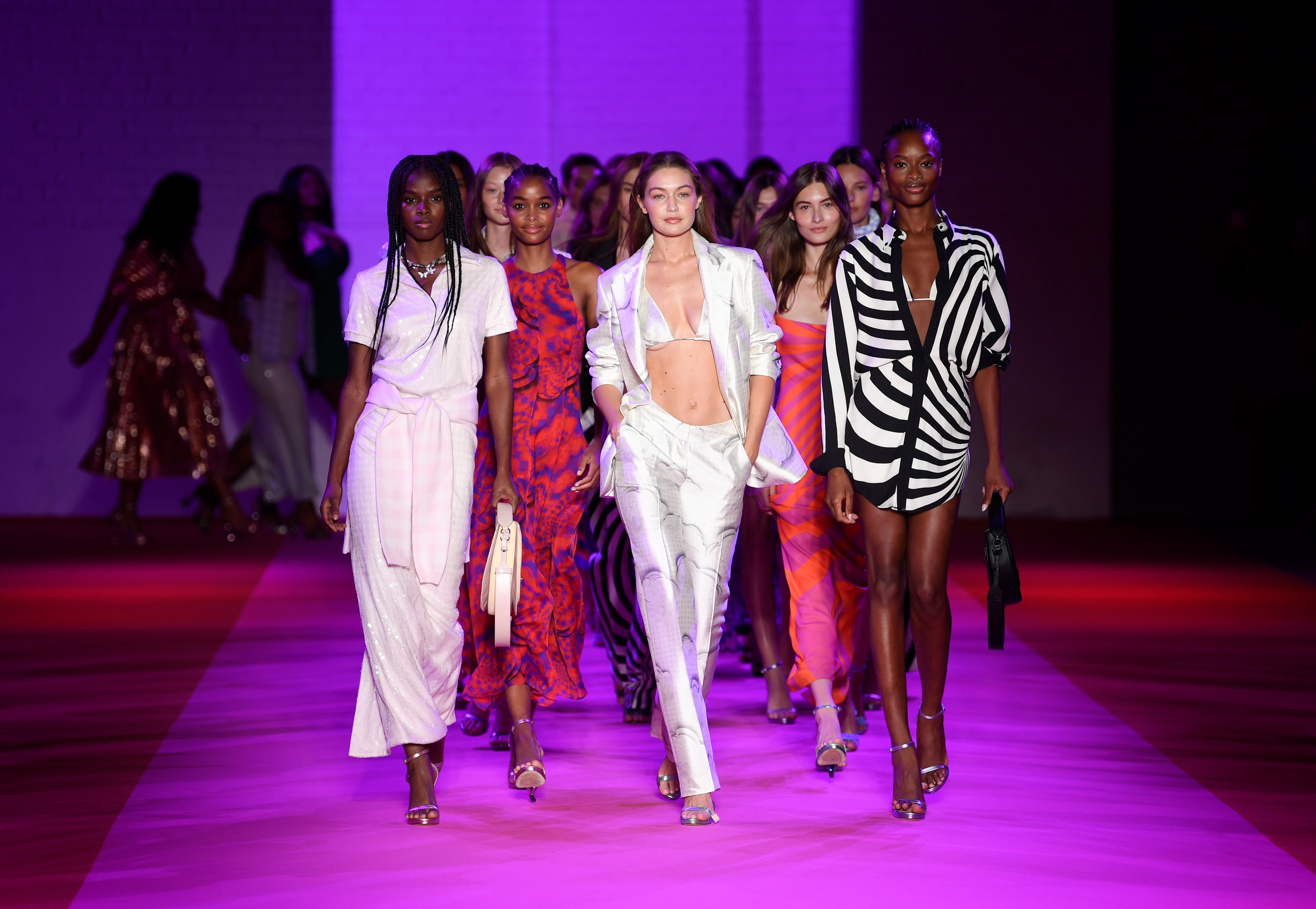Models, including Gigi Hadid, center, walk the runway during the finale at the Brandon Maxwell spring/summer 2022 fashion show.(Evan Agostini/Invision/AP)