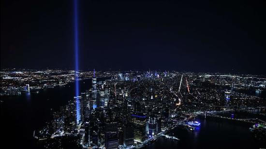 The Tribute In Light shines up from Lower Manhattan on September 11, 2021 in New York City. (AFP)