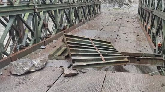 A bridge on National Highway number 5 was damaged at Urni in Kinnaur district of Himachal Pradesh due to shooting stones and a landslide triggered by rain on Monday. (HT Photo)