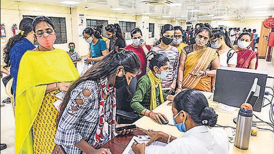 People register to receive Covid-19 vaccine dose, at Moti Lal Nehru Medical College, in Prayagraj on Monday. (PTI)