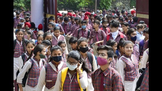 Social distancing and mask norms being flouted as students enter the examination centre at Government School, PAU, in Ludhiana on Monday. (Harsimar Pal SIngh/HT)