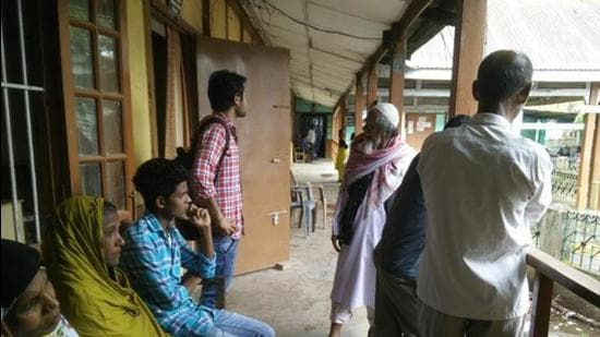 People wait outside the foreigners' tribunal office in Goalpara, Assam. (HT archive)