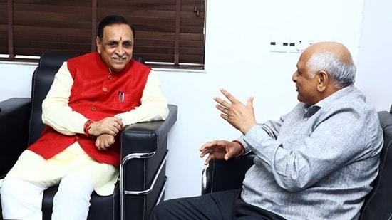 Bhupendra Patel meets former chief minister Vijay Rupani at his residence in Gandhinagar.(ANI Photo)