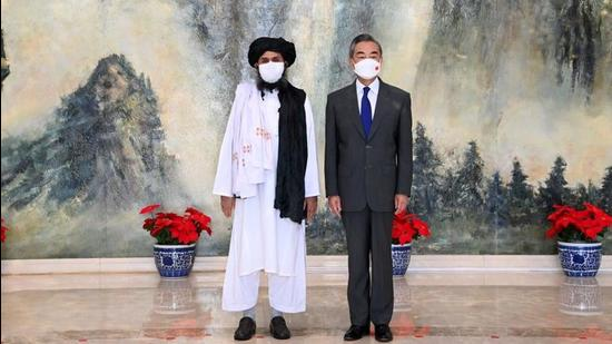 Chinese State Councilor and Foreign Minister Wang Yi meets with Mullah Abdul Ghani Baradar, political chief of Afghanistan's Taliban, in Tianjin, China, on July 28, 2021. China's enhanced diplomatic efforts primarily focus on securing Xinjiang against any jihadist influence, and Beijing does not seem to have any intention to involve itself in the treacherous territory of Afghanistan based on miscalculations of power and interests. (VIA REUTERS)