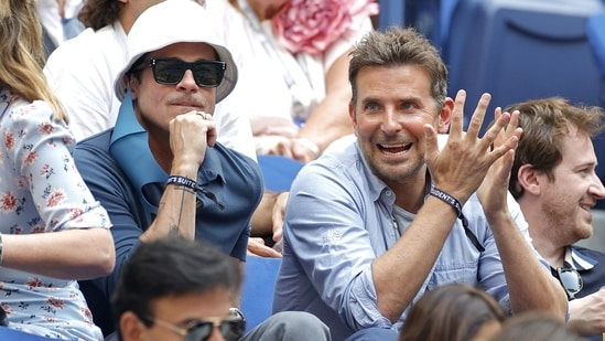 Brad Pitt and Bradley Cooper at the US open.(AFP)