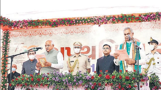 Gujarat governor Acharya Devvrat administers the oath to Bhupendra Patel as Gujarat chief minister, in Ahmedabad on Monday.