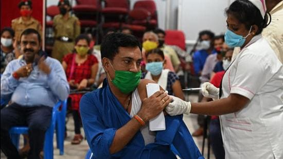 A health worker inoculates a man with a dose of Covid vaccine at a camp in Chennai on September 12. (AFP)