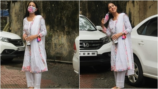 Sara teamed the kurta with straight-fit pants decorated with cut-out lace attached to the hems. Her off-duty ethnic look came together with a zari dupatta adorned with printed borders.(HT Photo/Varinder Chawla)