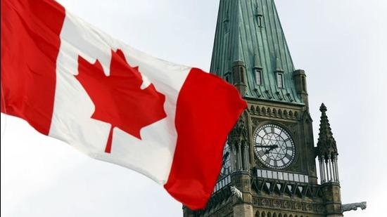 The Canadian flag flies on Parliament Hill in Ottawa. Two Indo-Canadian academics have claimed that the Canadian government is adopting double standards on Covid-19 testing for those stuck in India. (REUTERS)