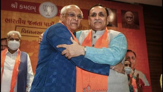 (From left) Bhupendra Patel with Vijay Rupani who he succeeded as the chief minister of Gujarat. (File photo)