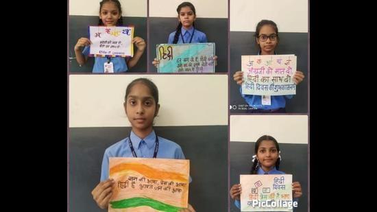 Students of BVM High School, Dugri, Ludhiana, showcasing their posters. (HT Photo)