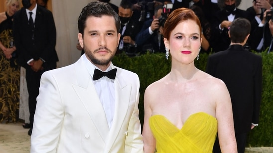 'Jon Snow' Kit Harington and 'Ygritte' Rose Leslie arrived in style at the Met Gala red carpet. The Game Of Thrones actors looked stunning and very much in love as they posed for the cameras. While Kit wore a white tuxedo, Rose chose a citrine sleeveless gown by Oscar de la Renta featuring a sweetheart neckline and pleated hemline.(AFP)