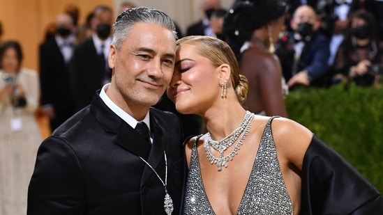 English singer-songwriter Rita Ora and New Zealand director-actor Taika Waititi shared an adorable moment at the Met Gala 2021. Reports suggested that the two even confirmed their engagement, as Rita was seen wearing a ring on her engagement finger. As for her clothes, she chose a sparkly two-piece by Prada with a black silk drape and complementing diamond jewellery.(AFP)