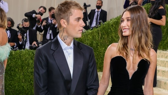 Justin Bieber and Hailey Bieber chose all-black outfits for their first Met Gala together. The couple were totally in love and earnestly looked into each other's eyes as they walked the red carpet hand-in-hand. Justin wore a dark suit with a Drew suitcase, and Hailey wore a black column gown with a plunging neckline from Saint Laurent.(AFP)