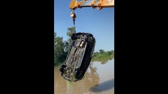 Police fished out the doctor's car from the Ludhiana canal. (HT Photo)