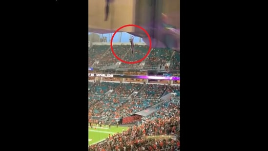 The video posted on Twitter shows cat dangling from a cable at Miami's Hard Rock Stadium during a college football game.(Twitter/@DannyWQAM)