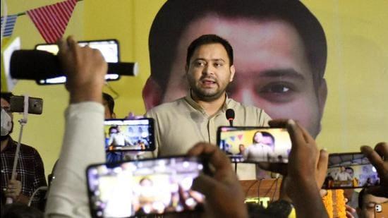 RJD leader Tejashwi Yadav addresses Milan Samaroh at party office in Patna on Tuesday. (Santosh Kumar/HT Photo)