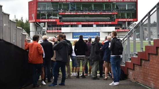 Fans look on as the 5th Test between India and England in Manchester is cancelled.(Getty)