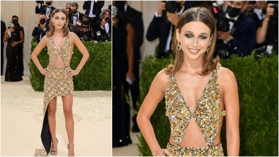 Emma Chamberlain went for a gold mini with cutouts at the waist and chunky mirror and chain detail.(AFP)