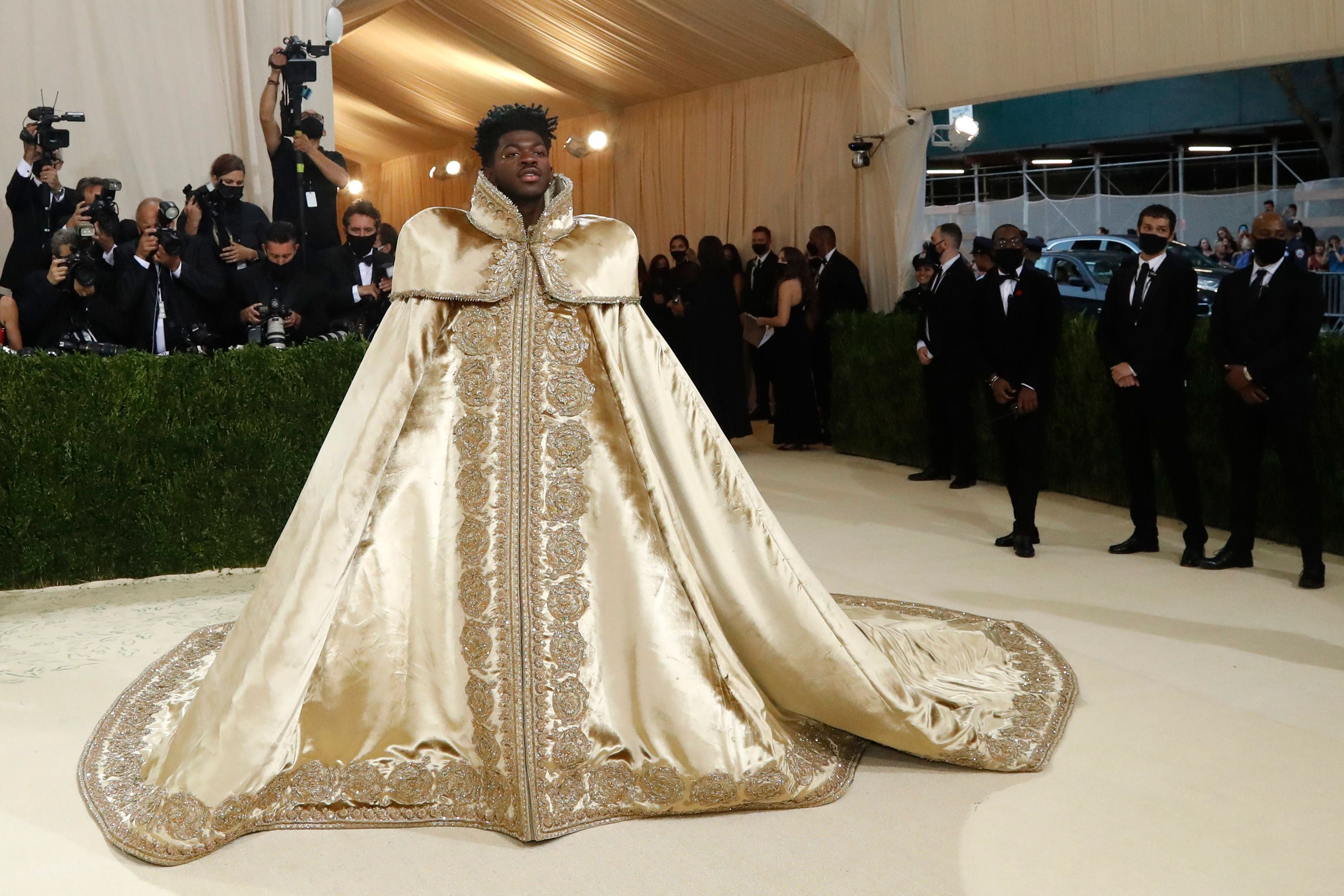 Rapper Lil Nas X wore Versace and pulled off not one, but three gold outfits.  (Reuters)