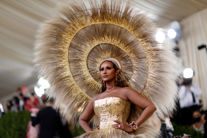 Iman opted for a stunning feathered gold and beige headdress and cage skirt.  (Reuters)