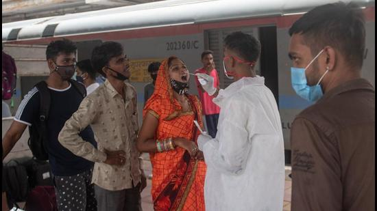 A healthcare worker collects swab sample for Covid-19 test of passengers at Dadar station in Mumbai. Maharashtra on Wednesday recorded 3,783 new cases along with 56 deaths (Pratik Chorge/HT PHOTO)
