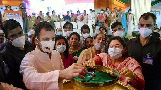 """Congress MP Rahul Gandhi lights a lamp during the celebration of the 38th foundation day of Mahila Congress, in New Delhi, on Wednesday. Gandhi said the RSS and BJP are """"fake Hindus"""" who only """"use religion for their benefits"""". (PTI)"""
