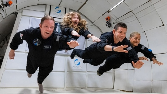 The Inspiration4 crew float in zero gravity while training for the mission.(AFP Photo)