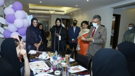 Indian ambassador Dr Deepak Mittal interacting with Afghan evacuees in Qatar on Tuesday.(Twitter/@IndEmbDoha)