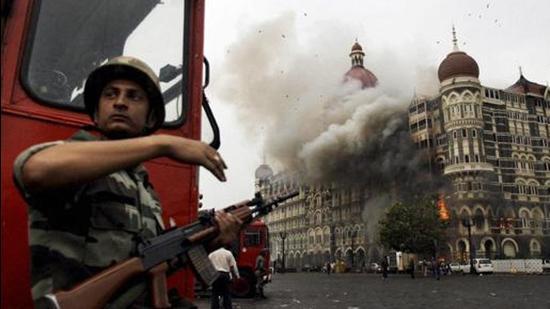 Smoke is seen billowing out of the ground and first floor of the Taj Hotel in south Mumbai during security personnel's Operation Cyclone following the 26/11 terror attacks in 2008. (File photo)