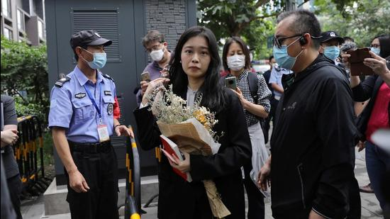 Zhou Xiaoxuan, also known by her online name Xianzi, arrives at a court for a sexual harassment case involving a Chinese state TV host, in Beijing, China on Tuesday. (REUTERS)