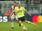 Besiktas' Francisco Montero, left, challenges for the ball with Dortmund's Erling Haaland during the Champions League Group C soccer match(AP)