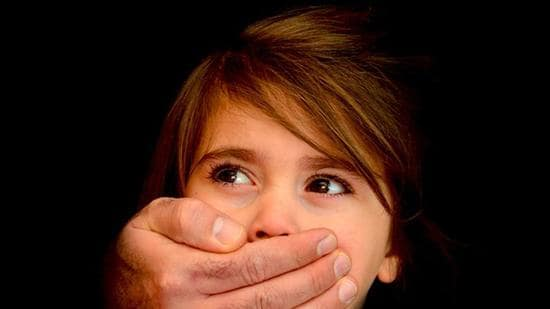 The suspect, in connivance with his accomplice, took the girl to a hotel room on Wednesday and molested her. (Representative image/Shutterstock)