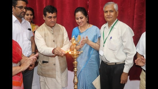 The lighting of the lamp ceremony in progress on Day 1 of the national conference on the role of yoga and naturopathy in the management of post Covid symptoms being held at Government College of Yoga Education and Health in Chandigarh. (HT photo)
