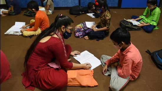 Poor students from pandemic-struck homes receiving free education and meals at an NGO in Navi Mumbai. Even as NGOs must be transparent and accountable, the State must see civil society as an ally and not as an adversary. (Representational image/HT PHOTO)