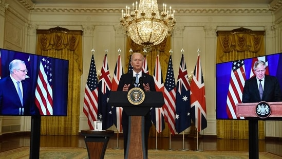US president Joe Biden participates in a virtual press conference on national security with British prime minister Boris Johnson (R) and Australian prime minister Scott Morrison in the east room of the White House in Washington, DC, on Wednesday.(AFP)