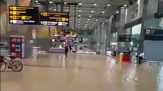 Waterlogging at Delhi's Indira Gandhi International Airport on Saturday. (PTI)