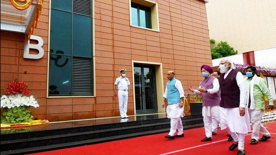 PM Modi, accompanied by defence minister Rajnath Singh and housing & urban affairs minister Hardeep Singh Puri, at the new defence office complex at KG Marg on Thursday. (ANI)