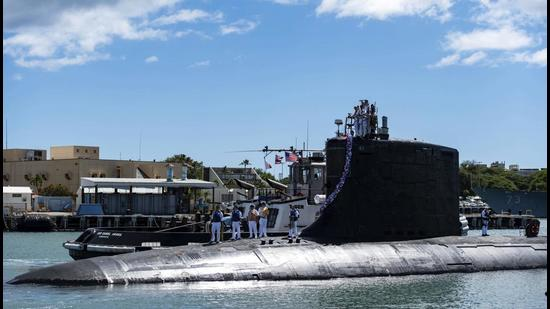 The Virginia-class fast-attack submarine USS Illinois returns home to Joint Base Pearl Harbour-Hickam from a deployment in the 7th Fleet area of responsibility on Monday. Australia decided to invest in US nuclear-powered submarines and dump its contract with France to build diesel-electric submarines because of a changed strategic environment, Prime Minister Scott Morrison said. (AP)