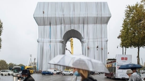 Masterpiece or monstrosity? Arc de Triomphe enveloped by Christo's artwork leaves tourists bemused