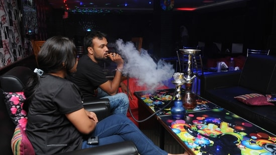 Delhi government standing counsel Santosh Kumar Tripathi said the use of hookah, be it with or without tobacco, in all public places, including hotels, restaurants, eateries, bars, pubs and discotheques, in the national capital is strictly prohibited(Diwakar Prasad/ Hindustan Times)