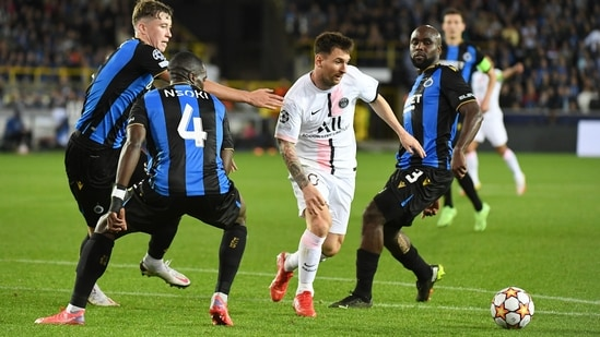 Paris St Germain's Lionel Messi in action with Club Brugge's Eder Balanta and Stanley N'Soki(REUTERS)