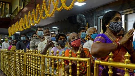 Devotees visit the Tirumala Tirupati Devasthanams temple on the occasion of 'Ugadi' festival in Chennai (AFP)