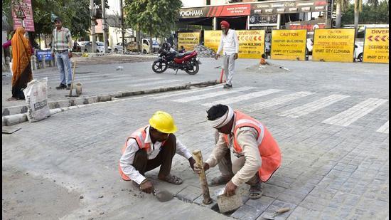 Construction work under the Smart City Mission in progress on Malhar road in Ludhiana on Thursday. (Gurpreet Singh/HT)
